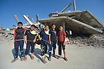 Boys pose for a picture in Shejaiya, a Gaza neighborhood which bore the brunt of some of the most intense Israeli air attacks during the 2014 war. Throughout Gaza, members of the ACT Alliance are supporting health care, vocational training, rehabilitation of housing and water systems, psycho-social care, and a variety of other humanitarian activities.