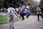 Berkeley CA First graders jumping rope at school recess