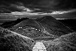 Stone path leads from the ancient Man Tor in Edale, Peak District, England