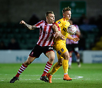 Lincoln City's Harry Anderson vies for possession with Northampton Town's Sam Hoskins<br /> <br /> Photographer Chris Vaughan/CameraSport<br /> <br /> Emirates FA Cup First Round - Lincoln City v Northampton Town - Saturday 10th November 2018 - Sincil Bank - Lincoln<br />  <br /> World Copyright © 2018 CameraSport. All rights reserved. 43 Linden Ave. Countesthorpe. Leicester. England. LE8 5PG - Tel: +44 (0) 116 277 4147 - admin@camerasport.com - www.camerasport.com
