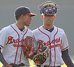Julio Teheran and Christian Bethancourt of the Rome Braves, Class A affiliate of the Atlanta Braves, in a game against the Greenville Drive April 14, 2010, at Fluor Field at the West End in Greenville, S.C. Photo by: Tom Priddy/Four Seam Images