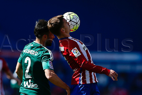 02.04.2016. Madrid, Spain.  Antonie Griezmann (7) Atletico de Madrid brings down a difficult ball against Francisco Molinero (2) Real Betis. La Liga match between Atletico de Madrid and Real Betis at the Vicente Calderon stadium in Madrid, Spain, April 2, 2016 .