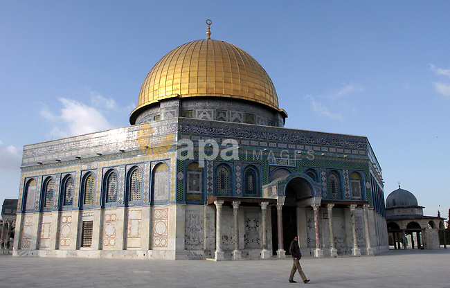 Palestinian Muslim walks past the Dome of Rock in the Al Aqsa Mosque compound, also known to Jews as the Temple Mount, in Jerusalem's old city, Wednesday, March 17, 2010. Israel on Wednesday lifted its tight restrictions on Palestinian access to Jerusalem's holiest shrine and called off an extended West Bank closure after days of clashes between Palestinians and Israeli security forces. Despite moving to end the lockdown, Israel still kept thousands of police officers on alert as an uneasy calm settled over the holy city. Photo by Mohamar Awad