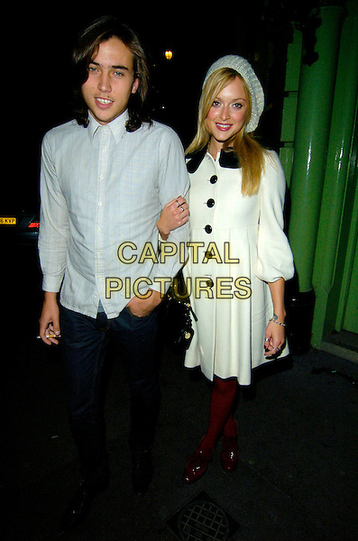"JESSE JENKINS & FEARNE COTTON.The ""Rent"" Press night afterparty at Jewell Bar, Covent Garden, London, England..October 15th, 2007.full length couple white shirt arms linked hat beret cream coat jacket red tights shoes black buttons jeans denim.CAP/CAN.©Can Nguyen/Capital Pictures"