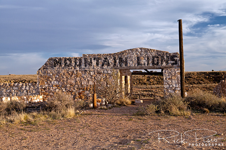 "The Mountain Lion attraction at Two Guns, Arizona, sits abandoned. Two Guns is located in Arizona, east of Flagstaff, on what was formerly Route 66. Two Guns was originally called ""Canyon Lodge"" when the National Trail Highway moved westward. Later, the National Trail was re-named Route 66, the site's name was changed to Two Guns, because the proprietor of the facilities located there was one Henry E. Miller, who called himself ""Two Gun Miller.""  During the heyday of Route 66, Two Guns became one of the numerous tourist traps along the way, with a gas station, overnighting accommodations, a food emporium, as well as a zoo. Two Guns went into decline with the building of the Interstate."