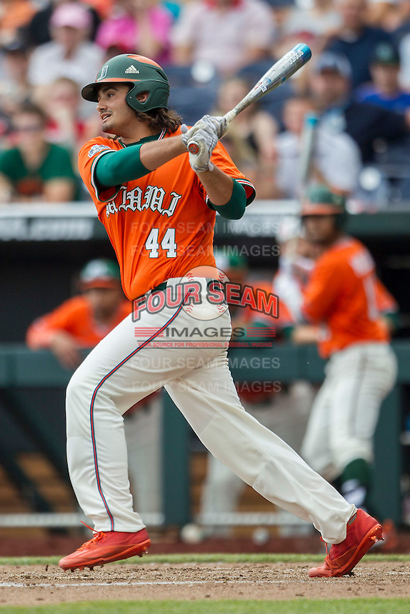 Miami Hurricanes pinch hitter Peter Crocitto (44) follows through on his swing against the UC Santa Barbara Gauchos in Game 5 of the NCAA College World Series on June 20, 2016 at TD Ameritrade Park in Omaha, Nebraska. UC Santa Barbara defeated Miami  5-3. (Andrew Woolley/Four Seam Images)