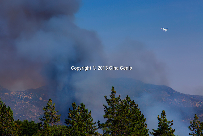 The DC 10 rises and banks towards Lake Hemet after dropping fire retardant on the Mountain Center fire on July 16, 2013.