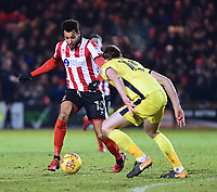 Lincoln City's Matt Green vies for possession with Cheltenham Town's William Boyle<br /> <br /> Photographer Andrew Vaughan/CameraSport<br /> <br /> The EFL Sky Bet League Two - Lincoln City v Cheltenham Town - Tuesday 13th February 2018 - Sincil Bank - Lincoln<br /> <br /> World Copyright &copy; 2018 CameraSport. All rights reserved. 43 Linden Ave. Countesthorpe. Leicester. England. LE8 5PG - Tel: +44 (0) 116 277 4147 - admin@camerasport.com - www.camerasport.com