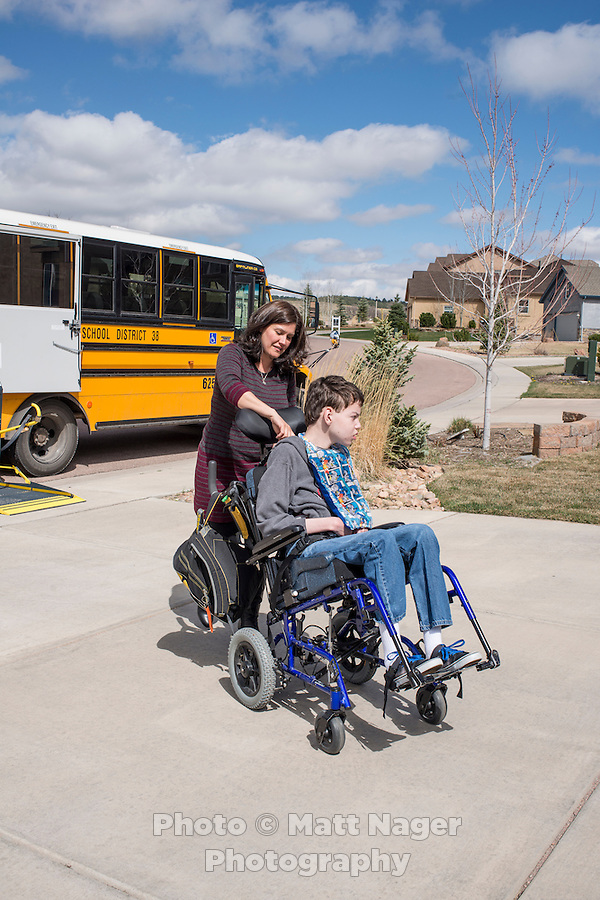 Rita Brown (cq), sits with her son Tyler Brown (cq, age 13), at their home in Monument, Colorado, Thursday, April 9, 2015. Tyler uses the Charlotte's Web strain of CBD high marijuana to help lessen his seizures and also help with pain.<br /> <br /> Photo by Matt Nager