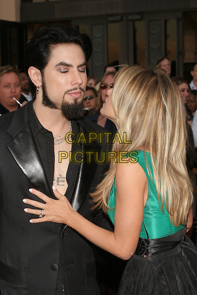 DAVE NAVARRO & CARMEN ELECTRA.33rd Annual American Music Awards - Arrivals held at the Shrine Auditorium. Los Angeles, California..USA, United States..22nd November 2005 .Ref:ADM/ZL.half length with together kissing kiss hand on chest engagement ring jewellery black open shirt tattoo.www.capitalpictures.com.sales@capitalpictures.com.© Capital Pictures..