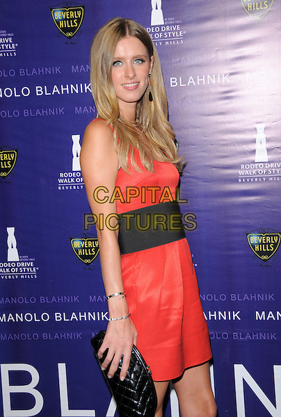 NICKY HILTON.The Rodeo Drive Walk of Style Awards Honoring Manolo Blahnik in Beverly Hills, California, USA. .September 25th, 2008.half length black clutch bag orange red dress belt.CAP/DVS.©Debbie VanStory/Capital Pictures.