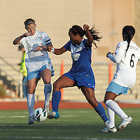 Boston Breakers midfielder Mariah Noguiera (20) attempts to control the ball as Chicago Red Stars midfielder Lori Chalupny (17) pressures. In a National Women's Soccer League Elite (NWSL) match, the Boston Breakers (blue) defeated Chicago Red Stars (white), 4-1, at Dilboy Stadium on May 4, 2013.