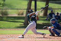 Oakland Athletics second baseman Cobie Vance (19) follows through on his swing during an Instructional League game against the Los Angeles Dodgers at Camelback Ranch on October 4, 2018 in Glendale, Arizona. (Zachary Lucy/Four Seam Images)
