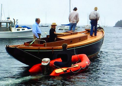 The restored Mavis, newly-launched in 2015, with Don O'Keeffe (nephew of Paddy O'Keeffe) on the tiller in the cockpit with Denise Pukas, and Ron Hawkins in the inflatable
