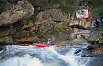November 5, 2016 - Hendersonville, North Carolina, Kayaker, Taylor Cofer, paddles through standing waves as he begins the drop into the Scream Machine Rapids during the 21st annual Green Race.The Green River Narrows provides one of the most intense and extreme whitewater venues in the world and is home to many of the USA's most talented paddlers.  Green River Narrows, Hendersonville, North Carolina.
