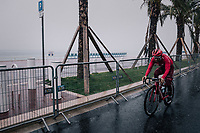 Tiago Machado (POR/Katusha-Alpecin) on his way to the race start on the Promenade des Anglais in torrential rained down Nice (and next to the Mediterranean Sea)<br /> <br /> 76th Paris-Nice 2018<br /> Stage 8: Nice > Nice (110km)