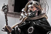 "The St. Domenico's procession in Cocullo, central Italy, May 1, 2008. Every year on the first Thursday of May, snakes are placed onto the statue of St. Domenico and then the statue is carried in a procession through the town. St. Domenico is believed to be the patron saint for people who have been bitten by snakes:..Italy, Cocullo, in the Province of L'Aquila, is at 870 meters a.s.l., along the railway line connecting Sulmona to Rome. The village rises alongside Mount Luparo (1327 meters) ""The valley opening in front of the village is surrounded by bare rocks, while on the other side, to the south, snow-capped mountain crests follow one after the other..."".he horseshoe marks above the door of a house in Cocullo commemorate the St. Dominick's female mule, the protagonist of some of the miracles inspired by the Saint. Myth and religion are the two sides of one same story. In a nearby area called ""Via del lupo"" (Wolf's Path), the oral tradition says there is the impression left by the knee of St. Dominick, who knelt down on the spot to recite his prayers...San Domenico Abate lived in the 10th and 11th centuries AD. Born in Foligno, in the Umbria region, he started his pilgrimages, preaching and ascetic practices in Central Italy, making miracles recorded by the word-of-mouth tradition. He died on 22 January 1031 and was buried in Sora...Cocullo snake charmers are over with their snake hunting. They proceeded through the During the procession on the first Thursday in May, before the snakes are placed all over the statue of St. Dominick, they will be fed with milk kept in containers with crusca. It is the snake that, most of all other elements, expresses an ancestral myth: the unknown aspect and unpredictability of the natural environment with man's innate need to achieve the dominance on his own habitat. .. ..Snakes and wolves were the emblems of Italic peoples like the Marsians and Irpinians. Some areas in Abruzzo, especially in the Sagittario valley, were under the me"