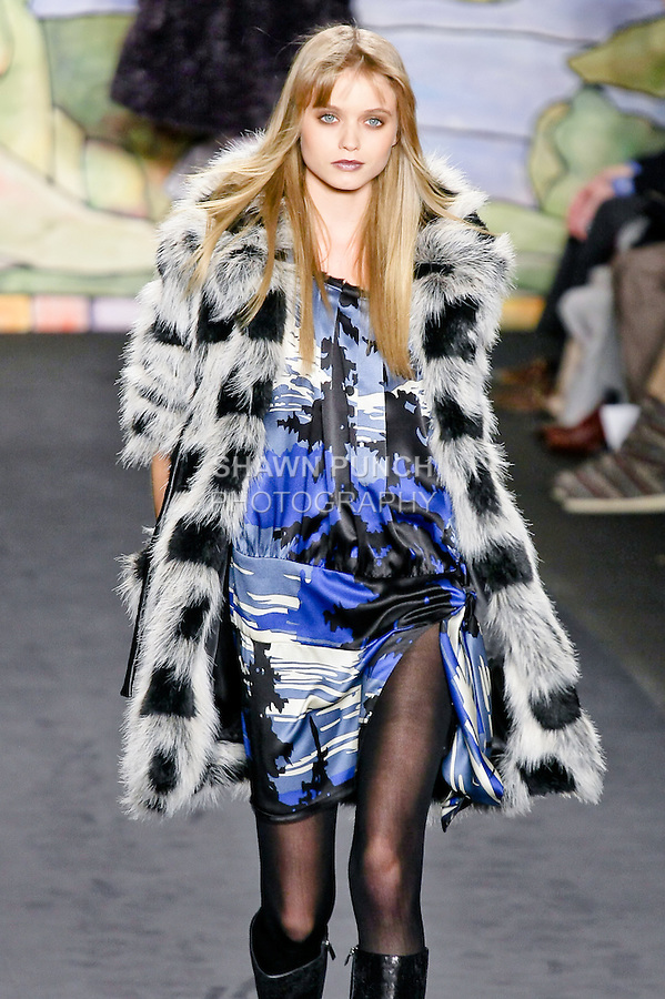 Abbey Lee Kershaw walks the runway in a black/cream checkerboard long haired faux fur coat, and american landscape print hammered satin dress, at the Anna Sui Fall 2010 fashion show, during Mercedes-Benz Fashion Week Fall 2010.
