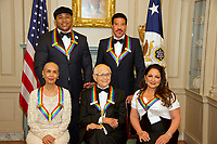 The five recipients of the 40th Annual Kennedy Center Honors pose for a group photo following a dinner hosted by United States Secretary of State Rex Tillerson in their honor at the US Department of State in Washington, D.C. on Saturday, December 2, 2017.  From left to right back row: LL Cool J and Lionel Richie  Front row, left to right: Carmen de Lavallade, Norman Lear and Gloria Estefan.  The 2017 honorees are: American dancer and choreographer Carmen de Lavallade; Cuban American singer-songwriter and actress Gloria Estefan; American hip hop artist and entertainment icon LL COOL J; American television writer and producer Norman Lear; and American musician and record producer Lionel Richie.  <br /> Credit: Ron Sachs / Pool via CNP /MediaPunch
