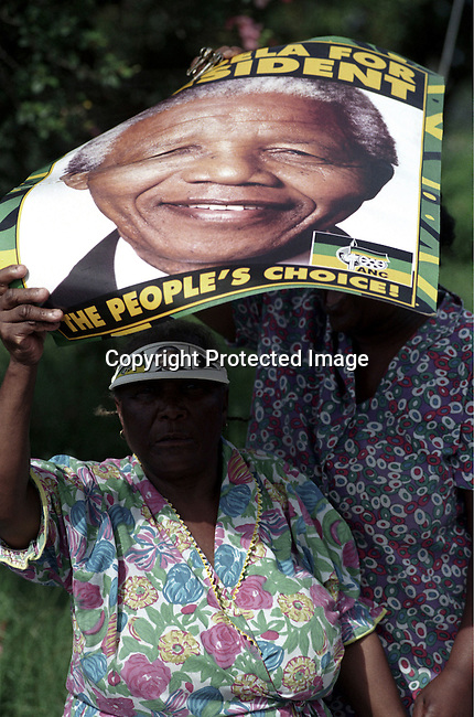 An old woman ANC supporter waiting for Nelson Mandela, the former president of South Africa on April 21, 1994 at a pre-election rally in Durban days before the historic democratic election on April 27, 1994 in South Africa. Mr Mandela became the first black democratic elected president in South Africa. He retired from office after one term in June 1999. .(Photo: Per-Anders Pettersson).