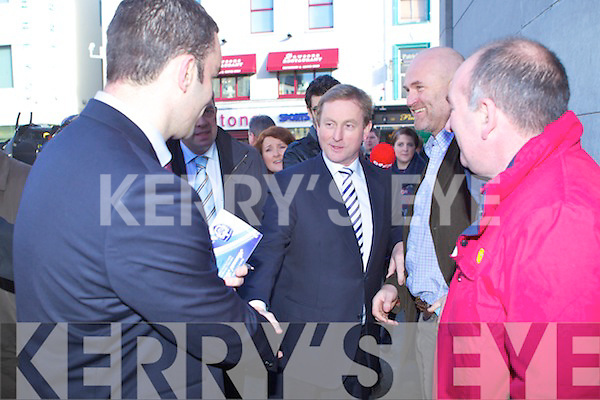Fine Gael Leader Enda Kenny, flanked by candidates Jimmy Deenihan and John Sheahan, doing a walkabout in Tralee on Thursday