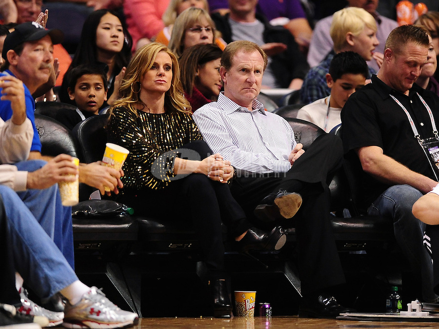 Jan. 28, 2012; Phoenix, AZ, USA; Phoenix Suns owner Robert Sarver (right) with wife Penny Sarver sit courtside against the Memphis Grizzlies at the US Airways Center. The Suns defeated the Grizzlies 86-84. Mandatory Credit: Mark J. Rebilas-USA TODAY Sports