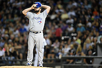 Toronto Blue Jays pitcher Todd Redmond (58) adjusts his hat before warming up during a game against the Chicago White Sox on August 15, 2014 at U.S. Cellular Field in Chicago, Illinois.  Chicago defeated Toronto 11-5.  (Mike Janes/Four Seam Images)