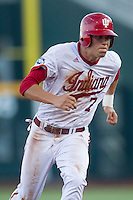 Indiana Hoosiers shortstop Michael Basil (7) runs to third base against the Mississippi State Bulldogs during Game 6 of the 2013 Men's College World Series on June 17, 2013 at TD Ameritrade Park in Omaha, Nebraska. The Bulldogs defeated Hoosiers 5-4. (Andrew Woolley/Four Seam Images)