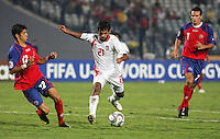 United Arab Emirates' Sultan Al Menhali (21) drives the ball past Costa Rica's Cristian Gamboa (12) and Marcos Urena (7) during the FIFA Under 20 World Cup Quarter-final match at the Cairo International Stadium in Cairo, Egypt, on October 10, 2009. Costa Rica won the match 1-2 in overtime play.