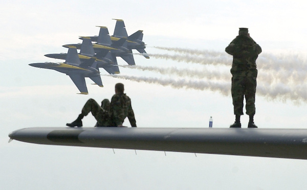 P.airshow.1.1019.jl.photo lytle.Nick Roberts, sitting, and Greg Parker both SRA Airforcemen watch the Blue Angles from the top of a wing of a 130 E Hercules airplane at the Mira Mar Air Show Saturday afternoon.