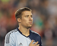 Sporting Kansas City defender Matt Besler (5). In the first game of two-game aggregate total goals Major League Soccer (MLS) Eastern Conference Semifinal series, New England Revolution (dark blue) vs Sporting Kansas City (light blue), 2-1, at Gillette Stadium on November 2, 2013.