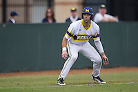Michigan Wolverines outfielder Jackson Glines (27) leads off of third base during the NCAA baseball game against the Washington Huskies on February 16, 2014 at Bobcat Ballpark in San Marcos, Texas. The game went eight innings, before travel curfew ended the contest in a 7-7 tie. (Andrew Woolley/Four Seam Images)