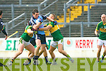 Ger Brennan Dublin bursts through the tackles of Barry John Keane and James O'Donoghue during Sunday League clash in Dublin