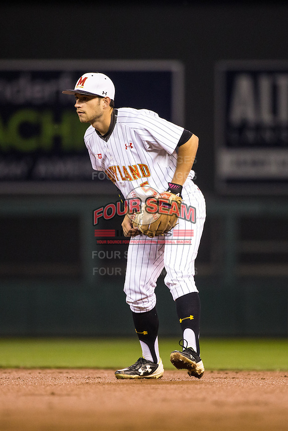 Brandon Lowe (5) of the Maryland Terrapins fields during a 2015 Big Ten Conference Tournament game between the Maryland Terrapins and Michigan State Spartans at Target Field on May 20, 2015 in Minneapolis, Minnesota. (Brace Hemmelgarn/Four Seam Images)