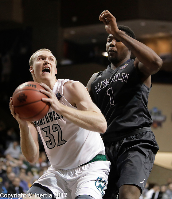 SIOUX FALLS, SD: MARCH 23: Brett Dougherty #32 of Northwest Missouri State drives past Chris Perry #1 of Lincoln Memorial during the Men's Division II Basketball Championship Tournament on March 23, 2017 at the Sanford Pentagon in Sioux Falls, SD. (Photo by Dick Carlson/Inertia)