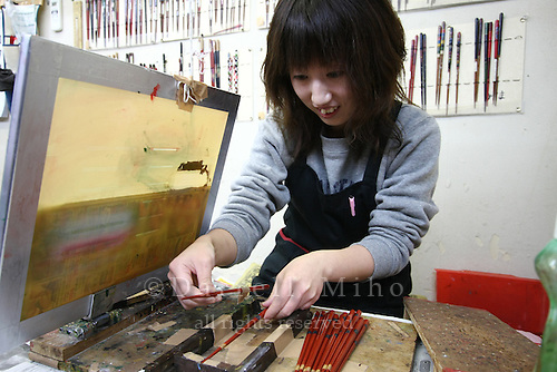 Jan. 21, 2009; Obama, Fukui Prefecture, Japan - Obama.  Seiko Morishita places hashi (chopsticks) in the screen printer at Hashi Minomoto.