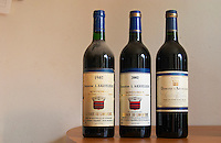 Aigueliere 1987, 2002 and Tradition 2003 with new label and Montpeyroux denomination. Domaine l'Aigueliere. Montpeyroux. Languedoc. France. Europe. Bottle.