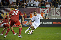 US midfielder Benny Fielhaber (22) maneuvers to evade Poland defender Dariusz Pietrasiak (24).  The U.S. Men's National Team tied Poland 2-2 at Soldier Field in Chicago, IL on October 9, 2010.