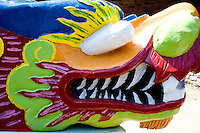 Artistic view of racing boat dragon head exhibited at the staging area. Dragon Festival Lake Phalen Park St Paul Minnesota USA