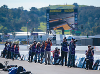 Feb 8, 2019; Pomona, CA, USA; NHRA photographers take photos as they stand alongside the trackside wall during qualifying for the Winternationals at Auto Club Raceway at Pomona. Mandatory Credit: Mark J. Rebilas-USA TODAY Sports