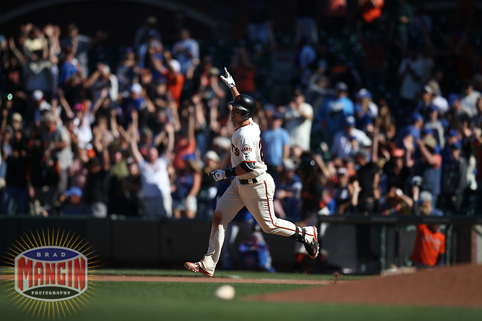 SAN FRANCISCO, CA - JULY 11:  Buster Posey #28 of the San Francisco Giants celebrates after hitting a game-winning double off the right field fence in the bottom of the 13th inning against the Chicago Cubs during the game at AT&T Park on Wednesday, July 11, 2018 in San Francisco, California. (Photo by Brad Mangin)
