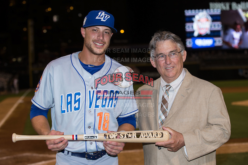 Travis Taijeron (left) of the Las Vegas 51s is presented with the Top Star Award from Pacific Coast League President Branch B. Rickey at the 29th Annual Triple-A All-Star Game at BB&T BallPark on July 13, 2016 in Charlotte, North Carolina.  The International League defeated the Pacific Coast League 4-2.   (Brian Westerholt/Four Seam Images)