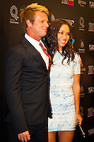 GOLD COAST, Queensland/Australia (Friday, February 24, 2012) Taj Burrow (AUS) with girlfriend Oleema Miller (USA).  The 29th Annual ASP World Surfing Awards went off tonight at the Gold Coast Convention and Exhibition Centre with the worlds best surfers trading the beachwear for formal attire as the 2011 ASP World Champions were officially crowned.. .Kelly Slater (USA), 40, and Carissa Moore (HAW), 19, took top honours for the evening, collecting the ASP World Title and ASP Womens World Title respectively.. .I have actually been on tour longer than some of my fellow competitors have been alive, Slater said. All joking aside, its truly humbling to be up here and honoured in front of such an incredible collection of surfers. I want to thank everyone in the room for pushing me to where I am...In addition to honouring the 2011 ASP World Champions, the ASP World Surfing Awards included new accolades voted on by the fans and the surfers themselves...For the first time in several years, ASP Life Membership was awarded to Hawaiian legend and icon of high-performance surfing, Larry Bertlemann (HAW), 56...Where surfing is today is where I dreamed it should be in the 70s, Bertlemann said. You guys absolutely deserve this and Im so honored to be up here in front of you all tonight..Grammy Award-winning artists Wolfmother and The Vernons rounded out the nights entertainment which was all streamed LIVE around the world on YouTube.com..Photo: joliphotos.com