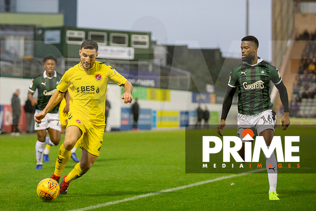 Lewis Coyle of Fleetwood Town takes on Joel Grant of Plymouth Argyle during the Sky Bet League 1 match between Plymouth Argyle and Fleetwood Town at Home Park, Plymouth, England on 25 November 2018. Photo by Mark Hawkins / PRiME Media Images.