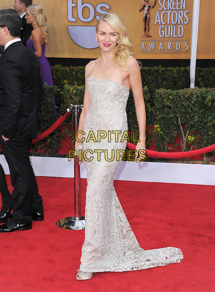 Naomi Watts (wearing Marchesa) .Arrivals at the 19th Annual Screen Actors Guild Awards at the Shrine Auditorium in Los Angeles, California, USA..27th January 2013.SAG SAGs full length grey gray lace strapless dress silver clutch bag hand on hip.CAP/DVS.©DVS/Capital Pictures.