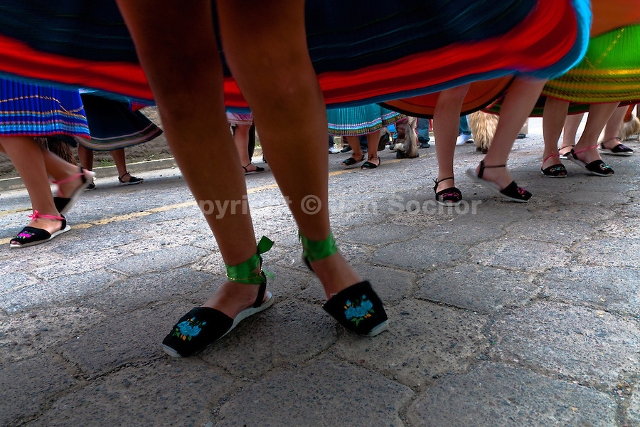 """Young girls, wearing colorful skirts, dance in a procession during the Inti Raymi celebration in Pichincha province, Ecuador, 27 June 2010. Inti Raymi, """"Festival of the Sun"""" in Quechua language, is an ancient spiritual ceremony held in the Indian regions of the Andes, mainly in Ecuador and Peru. The lively celebration, set by the winter solstice, goes on for various days. The highland Indians, wearing beautiful costumes, dance, drink and sing with no rest. Colorful processions in honor of the God Inti (Sun) pass through the mountain villages giving thanks for the harvest and expressing their deep relation to the Mother Earth (Pachamama)."""