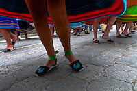 "Young girls, wearing colorful skirts, dance in a procession during the Inti Raymi celebration in Pichincha province, Ecuador, 27 June 2010. Inti Raymi, ""Festival of the Sun"" in Quechua language, is an ancient spiritual ceremony held in the Indian regions of the Andes, mainly in Ecuador and Peru. The lively celebration, set by the winter solstice, goes on for various days. The highland Indians, wearing beautiful costumes, dance, drink and sing with no rest. Colorful processions in honor of the God Inti (Sun) pass through the mountain villages giving thanks for the harvest and expressing their deep relation to the Mother Earth (Pachamama)."