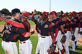 Batavia Muckdogs catcher Alex Jones (55) hugs Pablo Garcia (7) after defeating the Auburn Doubledays on September 5, 2016 at Dwyer Stadium in Batavia, New York.  Isaiah White (18), Corey Bird (12) and other teammates wait to congratulate each other after Batavia defeated Auburn 4-3. (Mike Janes/Four Seam Images)