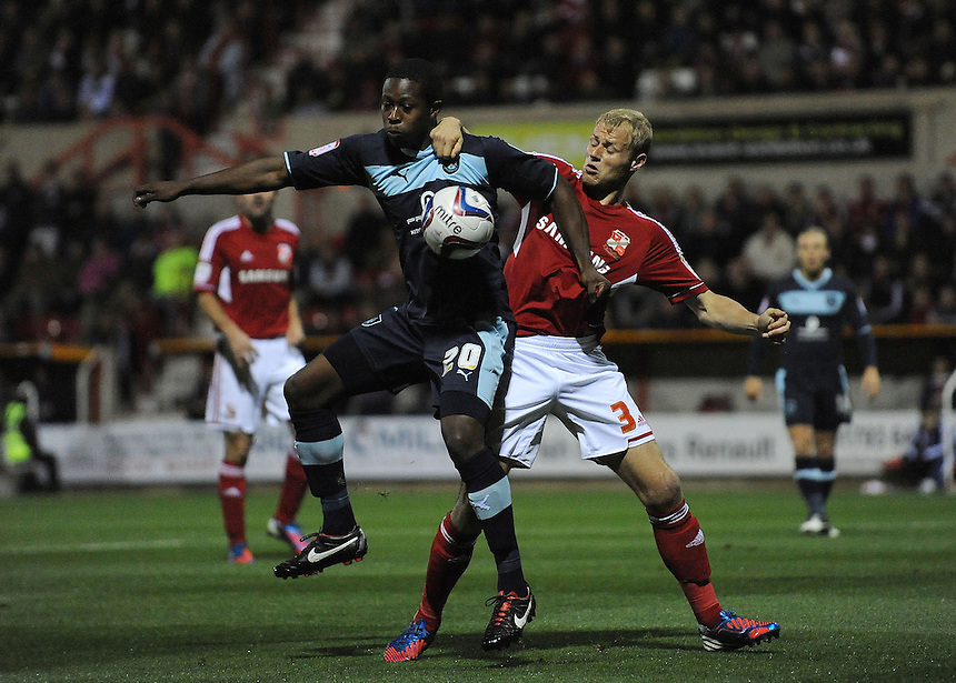 Burnley's Marvin Bartley shields the ball from Swindon Town's James McEveley ..Football - Capital One Cup Third Round - Swindon Town v Burnley - Tuesday 25th September 2012 - The County Ground - Swindon. .
