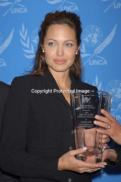 ..Angelina Jolie..at the United Nations to accept the First UNCA Citizen of the World Award from the United Nations Correspondents Association on October 22, 2003. Photo by Robin Platzer, ..Twin Images